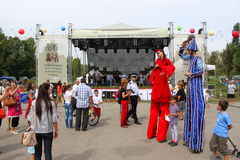 Clowns on stilts Stock Images