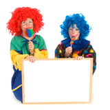 Clowns with text board. Two funny little clowns with board for text Stock Photos