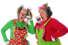 Clowns Using Tin Can Phone. Two clowns using a tin can phone to communicate Stock Photo