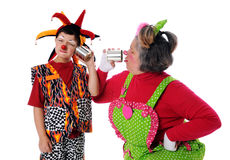 Clowns Using Tin Can Phones Stock Photo