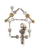 clés de maison effectuées Photo stock