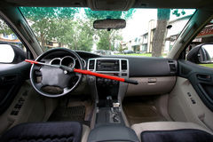 The Club. Steering club placed on steering wheel for additional security Stock Photos