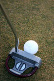 Club and ball. Golf putter and golfball Royalty Free Stock Images