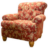 Club Chair. Country Style Club Chair  in a Red Paisley Fabric Pattern Royalty Free Stock Image