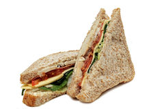 Club Chicken And Bacon Sandwich. A chicken and bacon sandwich with cheese, lettuce and tomato on a white background royalty free stock photography