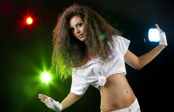 Club dancing woman. Young woman dancing in the club with disco lights Royalty Free Stock Photos