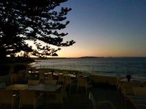 Club di golf di tramonto della spiaggia immagine stock libera da diritti