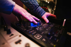 Club DJ playing mixing music on vinyl turntable Stock Photos