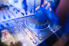Club DJ playing mixing music on vinyl turntable Royalty Free Stock Images