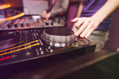 Club DJ playing mixing music on vinyl turntable Stock Images