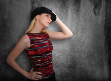 Club Girl Holding Hat on Grunge Background Stock Photography