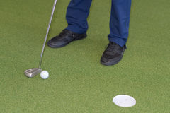 Club golf ball and hole on indoor golf course. Club golf ball and a hole on indoor golf course Stock Photography