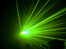 Club green laser. A green laser in a club Royalty Free Stock Photos