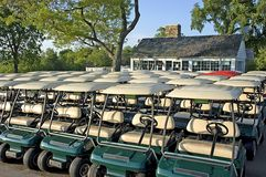 Club House and Golf Carts. Golf carts lined up outside the club house Stock Image