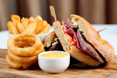 Club House Grill with onion rings Royalty Free Stock Photo