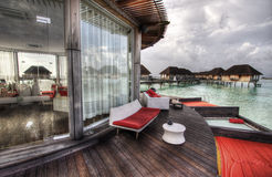 Club house on the water. A club house on top of the sea in Maldives stock photography