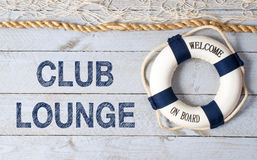 Club Lounge - Welcome on Board. Lifebuoy with text on wooden background stock photos