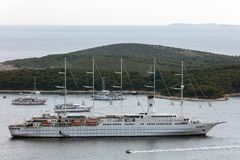 Club Med 2 sailing in Dalmatia. Club Med 2, a five-masted computer-controlled staysail schooner, sailing in Dalmatia. The ship combines seven computer-operated stock photo