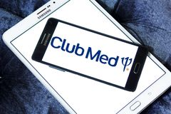 Club Med tourism company logo. Logo of Club Med tourism company on samsung mobile. Club Med is a private French company specializing in premium all inclusive royalty free stock photo
