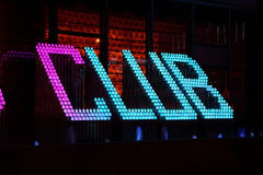 Club neon sign. Illuminated against a wall at night Stock Photography