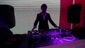 DJ on stage. Club night life, DJ show, Disco on the beach, DJ works, party in the club, DJ on stage, Disco in a nightclub, DJ working, Bright club party, Dj stock video footage