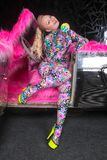 Club party blonde girl in acid anime style spandex catsuit with mirror car with pink fur ready for crazy clubbing life. Alone royalty free stock photos
