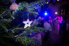 Club party in connection with the celebration of the new year an. D Christmas. Christmas tree with toys. People depicted in blur dance and have fun Stock Image