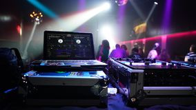 DJ Playing music in a night club. Rave party in the club with original dj, dancing and ngood mood Stock Photos