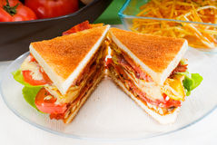 Club sandwich. Fresh and delicious classic club sandwich over a transparent glass dish Stock Photography