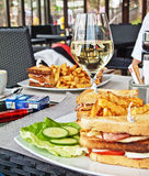Club sandwich. And fries on restaurant table stock images