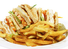 Club sandwich. Toasted chicken club sandwich with french frys Royalty Free Stock Photos