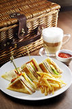 Club sandwich. French fries and cappuccino. With a smooth taste royalty free stock photo