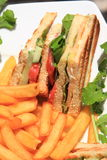 Club sandwich. With french fries royalty free stock images