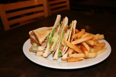 Club sandwich. With french fries Royalty Free Stock Photo