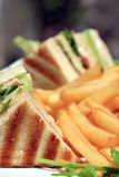 Club sandwich. With french fries royalty free stock photography