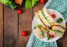 Club sandwich. With cheese, cucumber, tomato, ham and eggs. Top view stock photo
