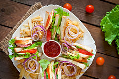 Club sandwich with cheese, cucumber, tomato, smoked meat and salami. Royalty Free Stock Photos