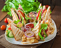 Club sandwich with cheese, cucumber, tomato, smoked meat and salami. stock photography