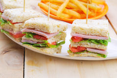 Club Sandwich with Cheese, Pickled Cucumber, Tomato and ham. Gar Stock Photo
