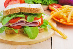 Club Sandwich with Cheese,  Tomato and ham. Royalty Free Stock Image