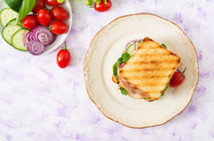 Club sandwich with chicken breast, bacon, tomato, cucumber and herbs. Royalty Free Stock Photography