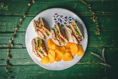 Club sandwich with chips royalty free stock photo