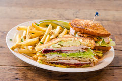 Club sandwich with coleslaw and pickles Royalty Free Stock Photos