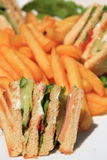 Club sandwich with french fries Stock Image