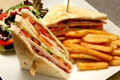 Club sandwich with french fries Stock Photos
