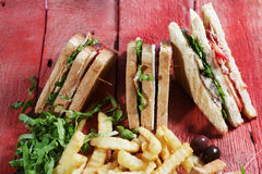 Club sandwich with fried potatoes Royalty Free Stock Photography