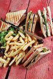 Club sandwich with fried potatoes Stock Image