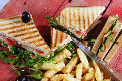 Club sandwich with fried potatoes Royalty Free Stock Image