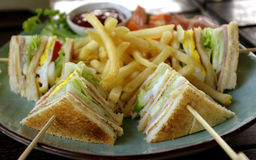 Club sandwich with fries. Club sandwich ham and cheese with fries and vegetable stock photography