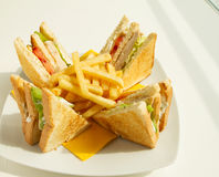 Club Sandwich. With fries on sunshine, arranged and splited royalty free stock images